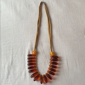 Leather and amber(?) necklace